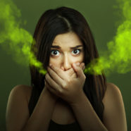 How are bleeding gums and bad breath related?